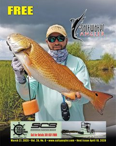 Brodie Cooper with a 28 inch redfish