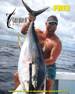 Capt. Adam Doelle with a 125 pound Yellowfin Tuna