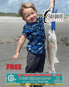 2 year old Boedy Martin with one of several red fish caught on Padre Island National Seashore with fishing guide Jeff Wolda.